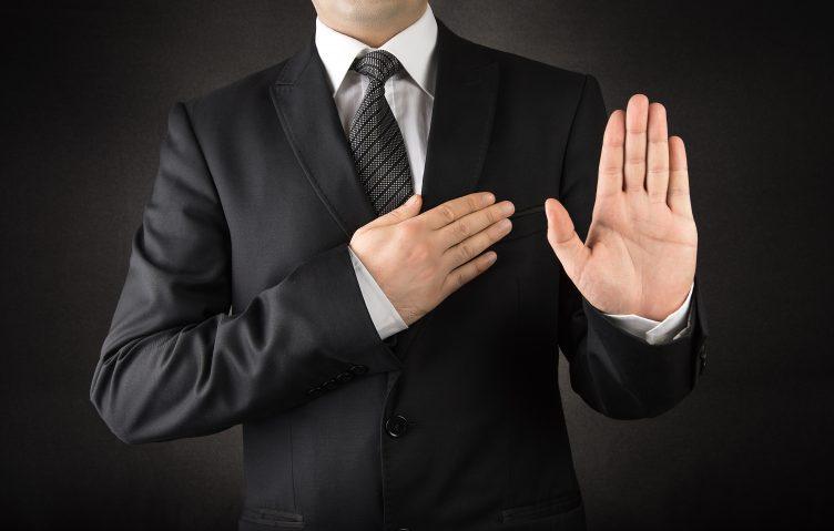 man swearing under oath